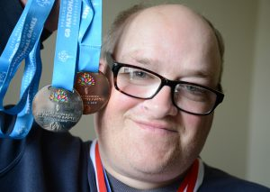 Barry Brown, a tenant from Redcar holding up his special Olympics medals