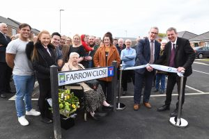 A photo of a North Star tenant, Ronnie, and North Star's Chair of the Board, Jed, with Hartlepool MP Mike Hill opening Farrow Close in Hartlepool
